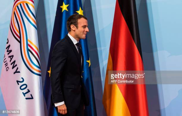 French President Emmanuel Macron arrives for a 'retreat meeting' on the first day of the G20 summit in Hamburg northern Germany on July 7 2017...