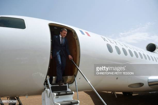 French President Emmanuel Macron arrives for a visit to the troops of France's Barkhane counterterrorism operation in Africa's Sahel region in Gao...