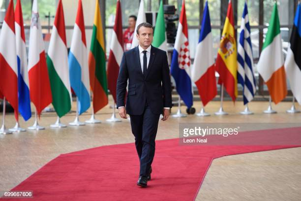 French President Emmanuel Macron arrives for his first summit since winning the Presidency at the EU Council headquarters ahead of a European Council...
