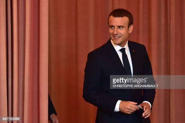 French President Emmanuel Macron arrives to vote at a polling station in Le Touquet northern France during the second round of the French...