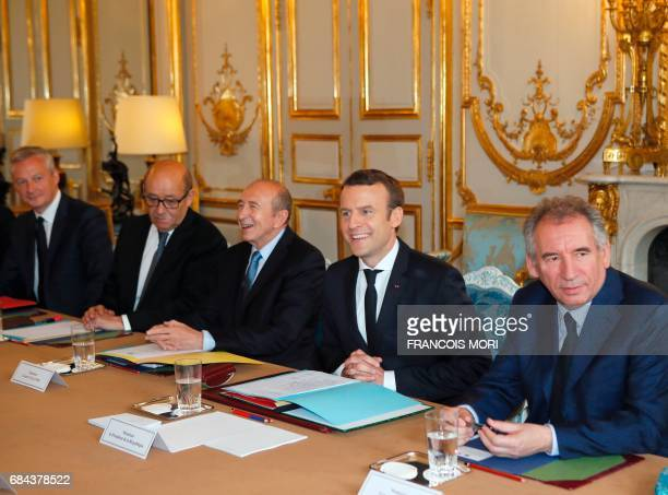 French President Emmanuel Macron attends a cabinet meeting with his newly named ministers Justice minister Francois Bayrou Interior minister Gerard...