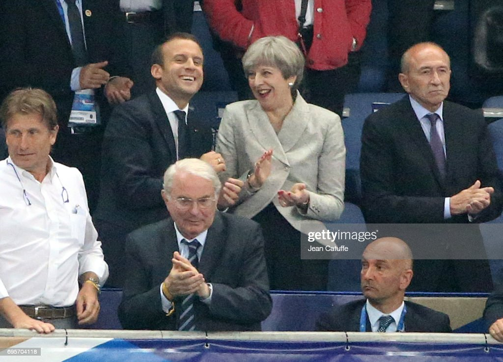 French President Emmanuel Macron, British Prime Minister Theresa May, French Minister of the Interior Gerard Collomb react following the international friendly match between France and Englan at Stade de France on June 13, 2017 in Saint-Denis near Paris, France.