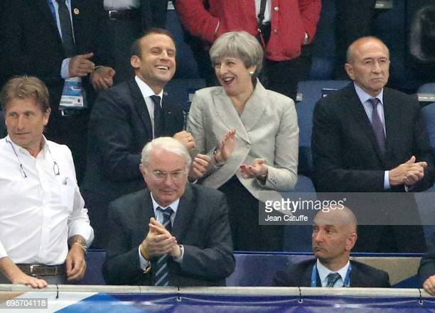 French President Emmanuel Macron British Prime Minister Theresa May French Minister of the Interior Gerard Collomb react following the international...