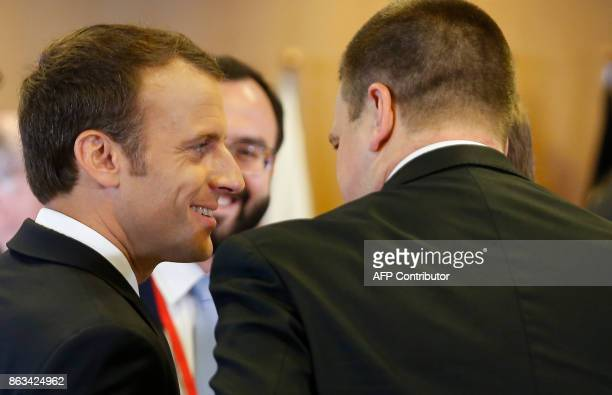 French President Emmanuel Macron chats with Estonia Prime Minister Juri Ratas on the second day of the European Council Meeting in Brussels on...