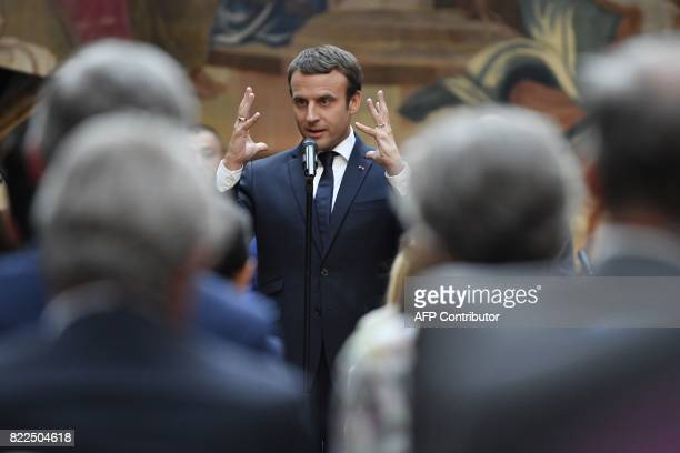 TOPSHOT French President Emmanuel Macron delivers a speech before a concert by the Pierre Claver Association at the Elysee Palace in Paris on July 25...