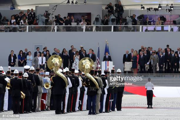 French President Emmanuel Macron delivers a speech next to Brigitte Macron US President Donald Trump and US First Lady Melania Trump during the...