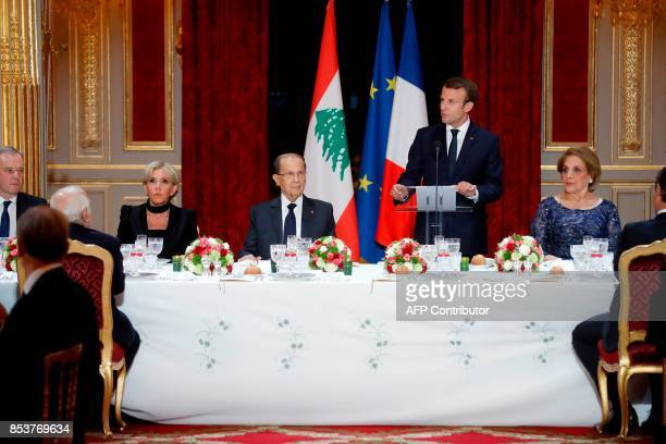 French President Emmanuel Macron delivers a speech next to Lebanon's President General Michel Aoun Aoun's wife Nadia Al Chami and the French...