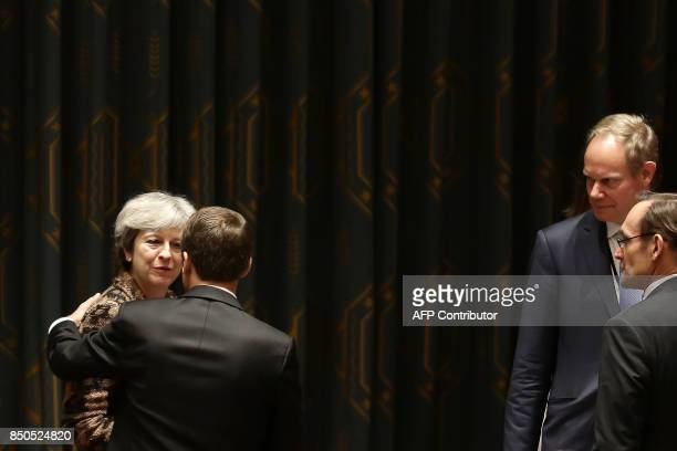 French President Emmanuel Macron embraces British Prime Minister Teresa May as they participate in an open debate of the United Nations Security...