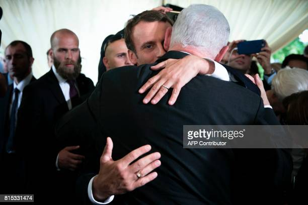 French President Emmanuel Macron embraces Israeli Prime Minister Benjamin Netanyahu during a ceremony commemorating the 75th anniversary of the Vel...