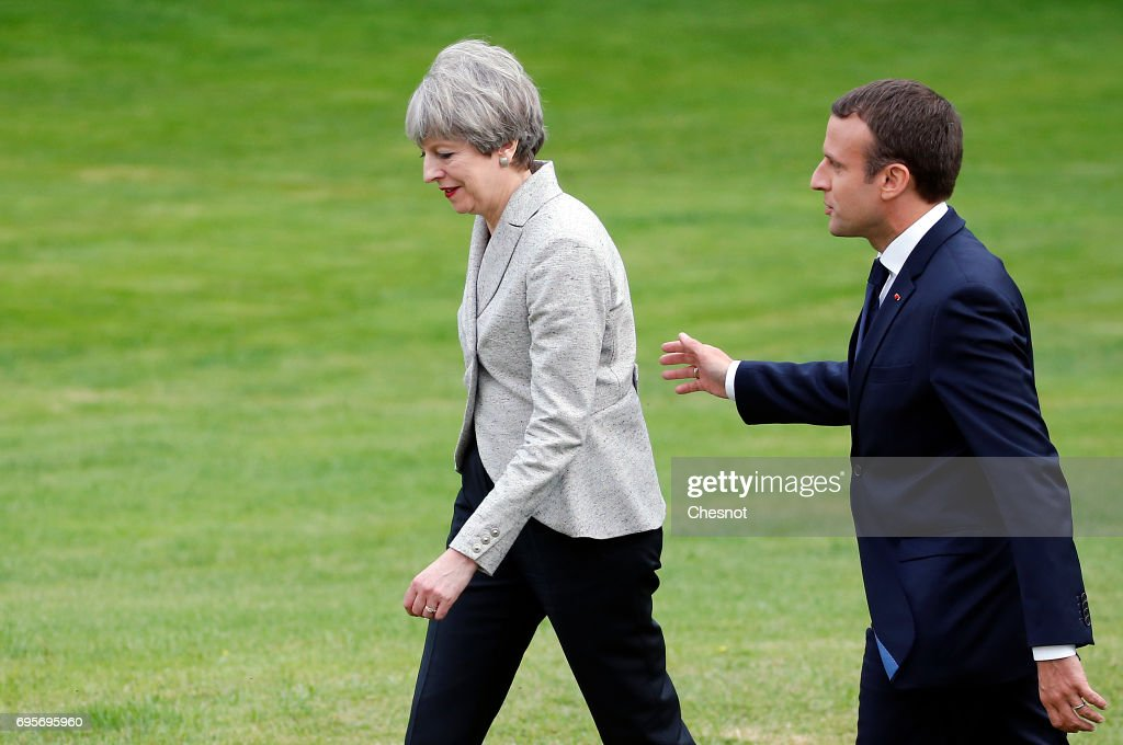 French President Emmanuel Macron escorts British Prime Minister Theresa May after their joint press conference at the Elysee Presidential Palace on June 13, 2017 in Paris, France. May met Macron to discuss the fight against radicalization and terrorism. They will then go to the stadium of France to pay tribute to the victims of the recent terrorist attacks of London and Manchester before the start of the match of football France-England.
