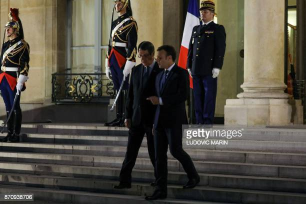 French President Emmanuel Macron escorts his Cypriot counterpart Nicos Anastasiades as he leaves following their meeting at the Elysee palace on...