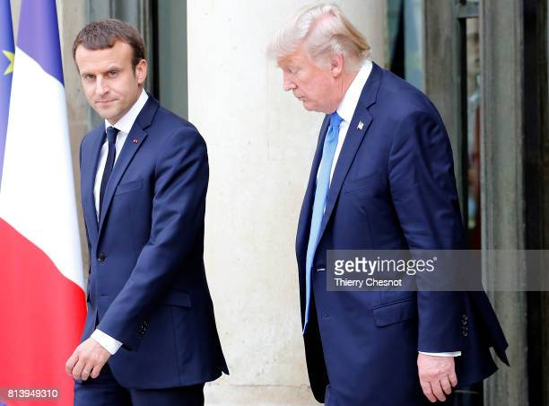 French President Emmanuel Macron escorts US President Donald Trump after their meeting at the Elysee Presidential Palace on July 13 2017 in Paris...