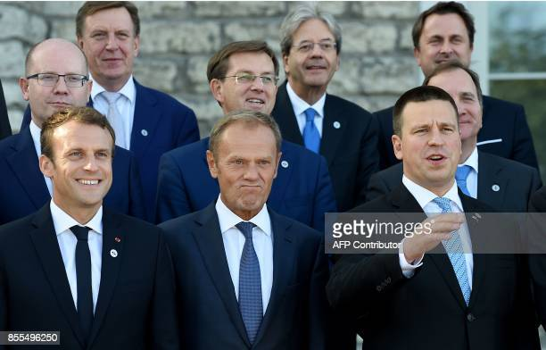 French President Emmanuel Macron European Council President Donald Tusk and Estonian Prime Minister Juri Ratas and other participants pose for a...