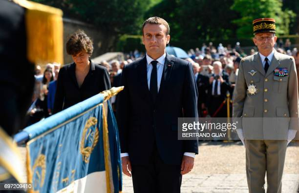 French President Emmanuel Macron flanked by Chief of the Defence Staff French army General Pierre de Villiers and French Minister of the Armed Forces...