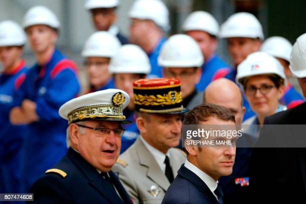 French President Emmanuel Macron flanked by Chief of the Defence Staff French Army General Pierre de Villiers and Chief of the Military Staff of the...