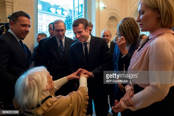 French President Emmanuel Macron flanked by director of the Picasso museum Laurent Le Bon is greeted by daughter of late Spanish painter Pablo...