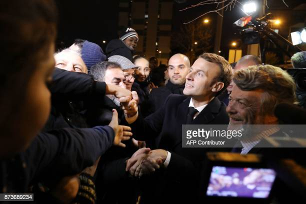 French President Emmanuel Macron flanked by former French minister and President of the Fondation Energies pour l'Afrique JeanLouis Borloo shakes...