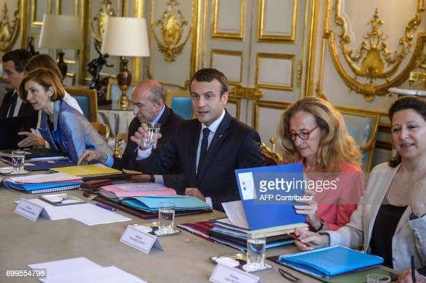 French President Emmanuel Macron flanked by French Defence Minister Florence Parly French Interior Minister Gerard Collomb French Justice Minister...