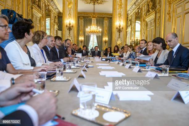 French President Emmanuel Macron flanked by French Junior Defence Minister Genevieve Darrieussecq French Minister of Higher Education Research and...