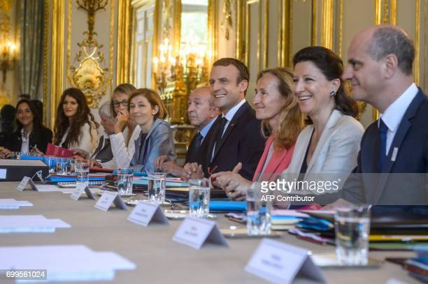 French President Emmanuel Macron flanked by French Minister attached to the Minister of Ecological and Inclusive Transition Brune Poirson French...