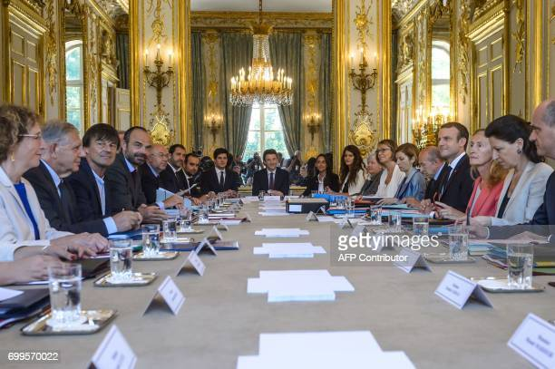 French President Emmanuel Macron flanked by French Minister of Labour Muriel Penicaud French Minister of Territorial Cohesion Jacques Mezard French...