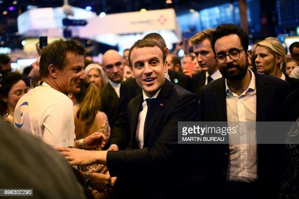 French president Emmanuel Macron flanked by French Minister of State for the Digital Sector Mounir Mahjoubi arrive at the Viva technology event...