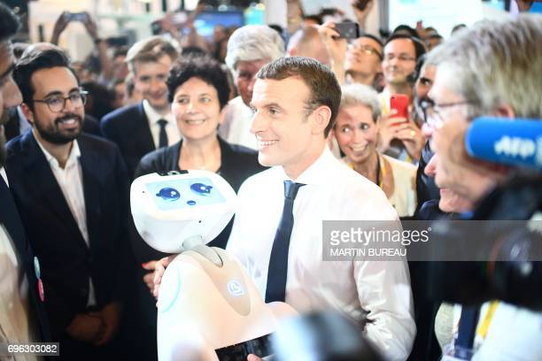 French president Emmanuel Macron flanked by French Minister of State for the Digital Sector Mounir Mahjoubi and French Minister of Higher Education...