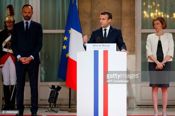 French President Emmanuel Macron flanked by French Prime Minister Edouard Philippe and French Defence Minister Florence Parly delivers a speech...