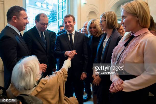 French President Emmanuel Macron flanked by his wife Brigitte Macron French Culture Minister Francoise Nyssen director of the Picasso museum Laurent...