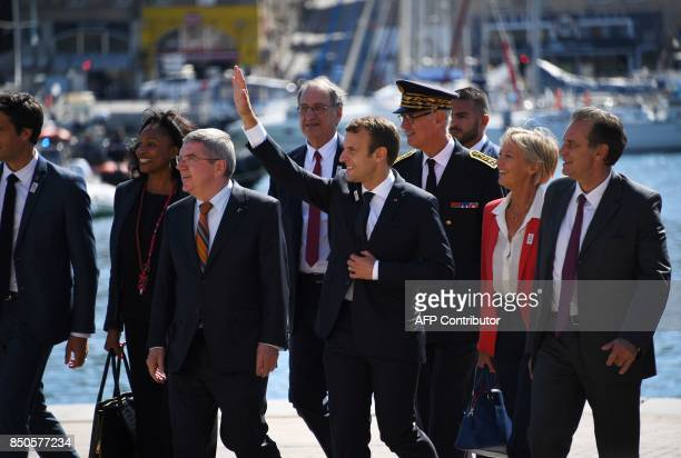 French President Emmanuel Macron flanked by International Olympic Committee member and CoChairman of Paris 2024 Tony Estanguet Minister for Sports...