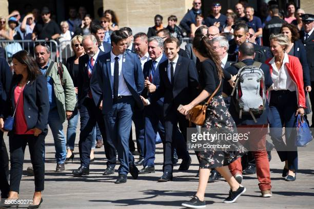 French President Emmanuel Macron flanked by International Olympic Committee member and CoChairman of Paris 2024 Tony Estanguet visits the site of the...