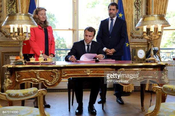 French President Emmanuel Macron flanked by Justice Minister Nicole Belloubet and Junior Minister for the Relations with Parliament and Government...