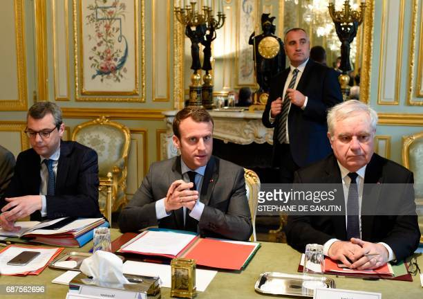 French president Emmanuel Macron flanked by Secretary General of the Elysee presidential Palace Alexis Kohler and Admiral Bernard Rogel attend a...