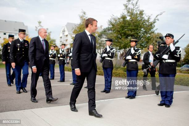 French President Emmanuel Macron followed by French Interior minister Gerard Collomb reviews an honor guard as he arrives to visit Gendarmerie...