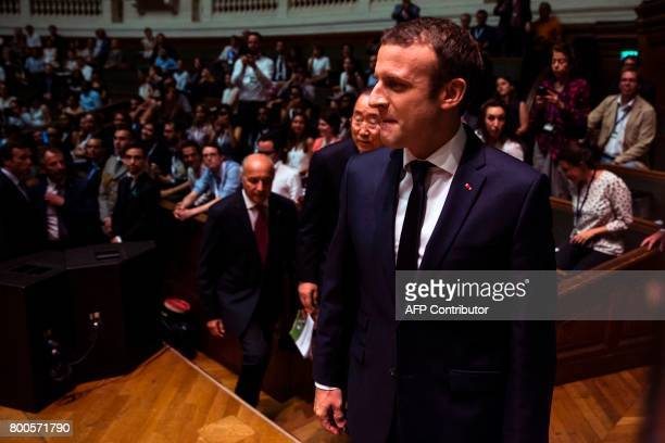 French President Emmanuel Macron former UN SecretaryGeneral Ban Kimoon and former French Foreign Minister Laurent Fabius attend the World Environment...