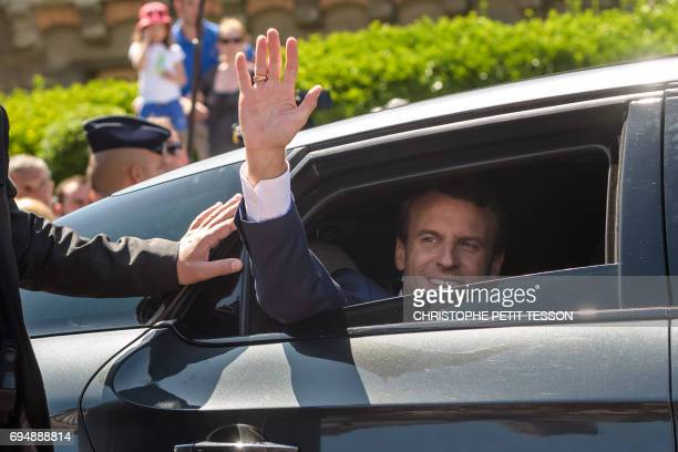 French President Emmanuel Macron from a car after voting at a polling station during the first round of the French legislative election in Le Touquet...