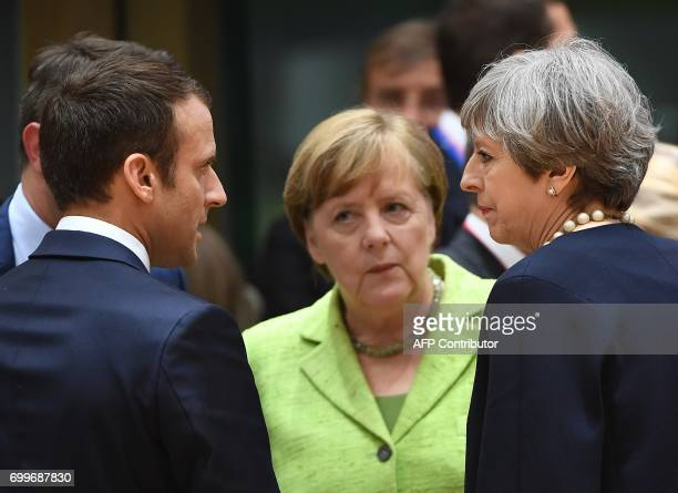 French President Emmanuel Macron German Chancellor Angela Merkel and British Prime Minister Theresa May talk as they attend an European Union leaders...