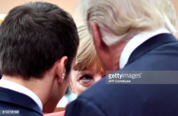 French President Emmanuel Macron German Chancellor Angela Merkel and US President Donald Trump confer at the start of the first working session of...