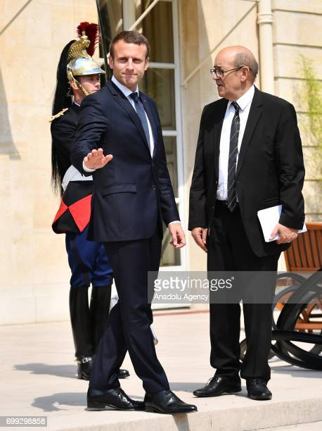 French President Emmanuel Macron gestures as Crown Prince Mohammed Bin Zayed Al Nahyan of the United Arab Emirates leaves after their meeting at the...