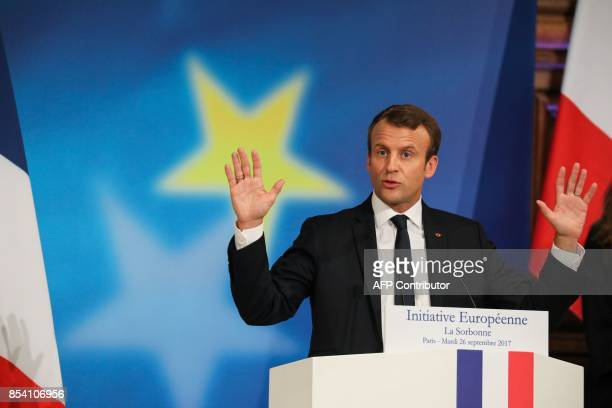 French President Emmanuel Macron gestures as he delivers a speech on the European Union at the amphitheater of the Sorbonne University on September...