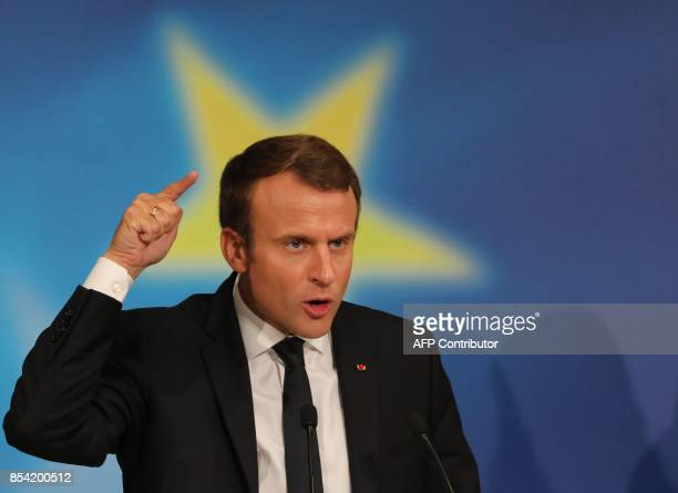 French President Emmanuel Macron gestures as he delivers a speech on the European Union in the amphitheatre of the Sorbonne University in Paris on...