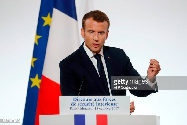 French President Emmanuel Macron gestures as he delivers a speech on security to representatives of French national police Gendarmes and 'Sentinelle'...