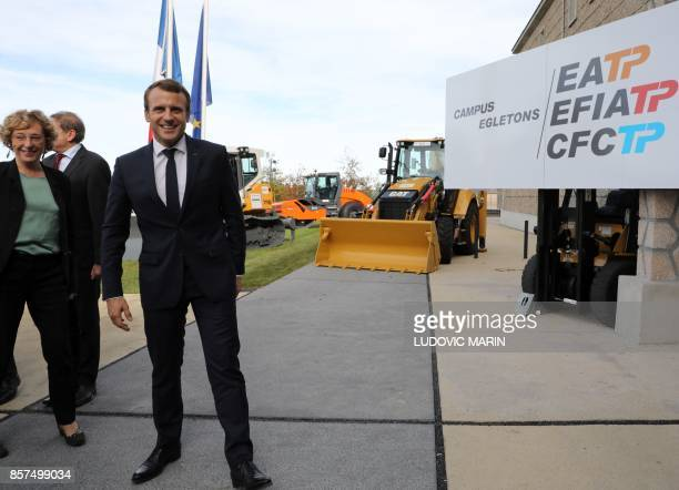 French President Emmanuel Macron gestures as he stands alongside Minister of Employment Muriel Penicaud during a visit to The School of Application...