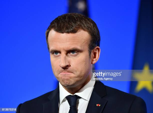 French President Emmanuel Macron gestures during a joint press conference held with US President Donald Trump after their meeting at the Elysee...
