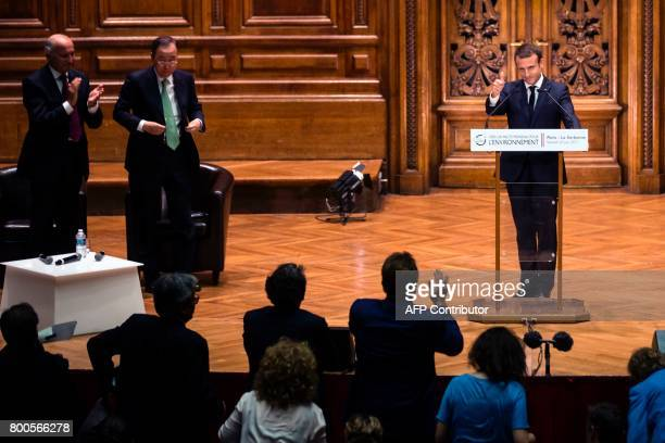 French President Emmanuel Macron gestures while delivering a speech as former UN SecretaryGeneral Ban Kimoon and former French Foreign Minister...
