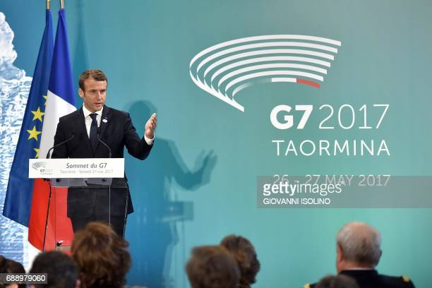 French President Emmanuel Macron gives a press conference at the end of a G7 summit of Heads of State and of Government on May 27 2017 in Taormina...