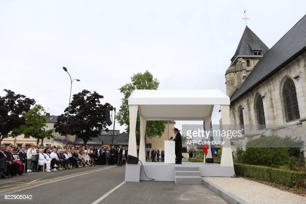 French President Emmanuel Macron gives a speech after attending a mass marking the first anniversary of the killing the French Catholic priest by two...