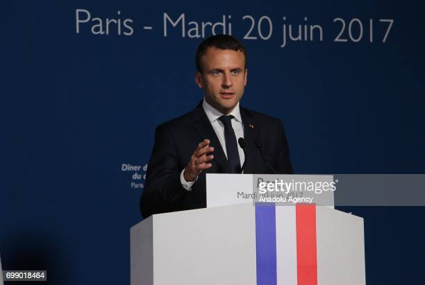 French President Emmanuel Macron gives a speech during an Iftar dinner organized by the French Council of the Muslim Faith within the Muslim's Holy...
