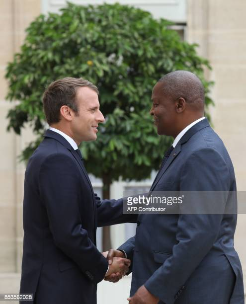 French president Emmanuel Macron greets Central African Republic's president FaustinArchange Touadera upon his arrival for their meeting at the...