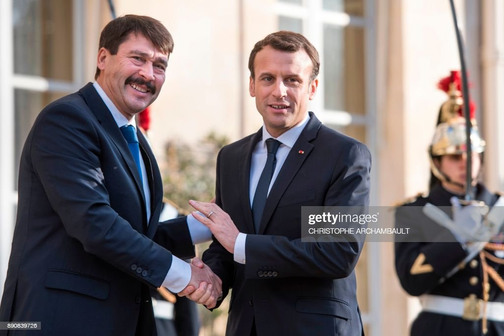 French President Emmanuel Macron (R) greets his Hungarian counterpart Janos Ader upon his arrival for their meeting on December 12, 2017 as part of the One Planet Summit. The French President hosts 50 world leaders for the 'One Planet Summit', hoping to jump-start the transition to a greener economy two years after the historic Paris agreement to limit climate change.